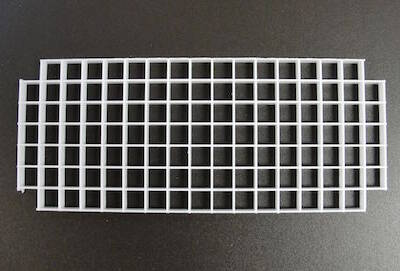 plastic grid to place in paraffin wax melter
